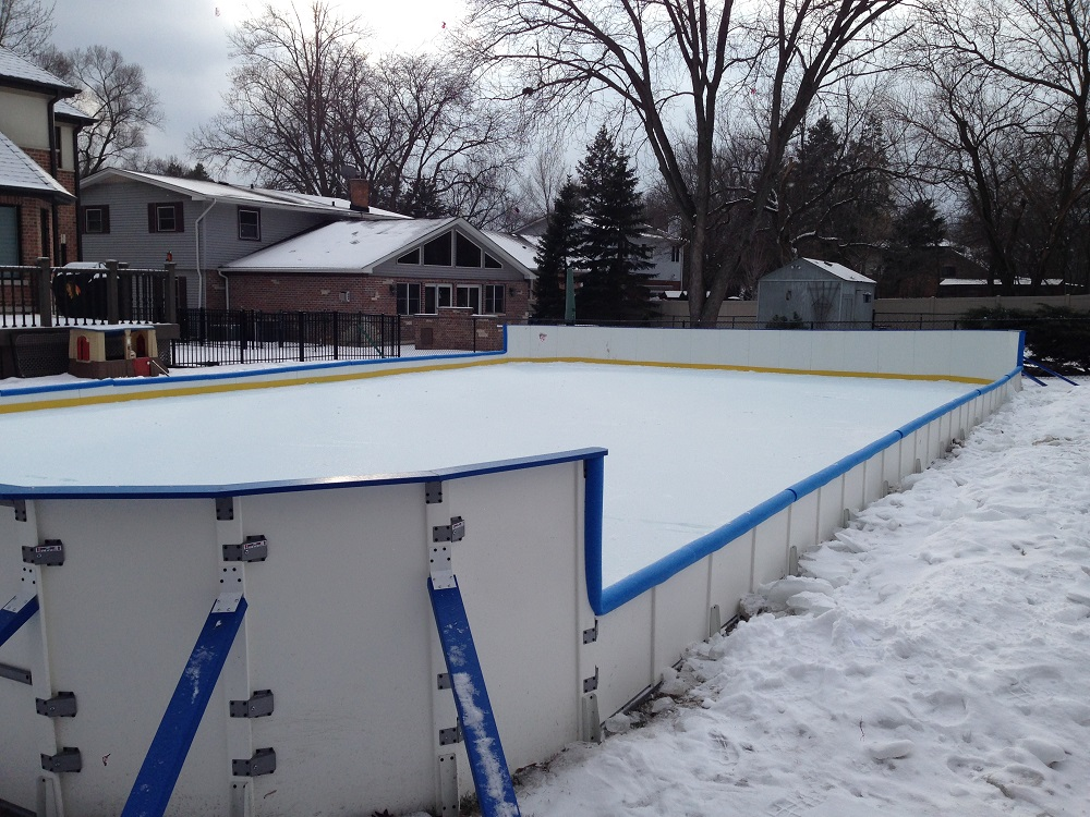 Plastic backyard ice rink boards with tall backboards - Custom Ice Rinks - Backyard Rink Installations