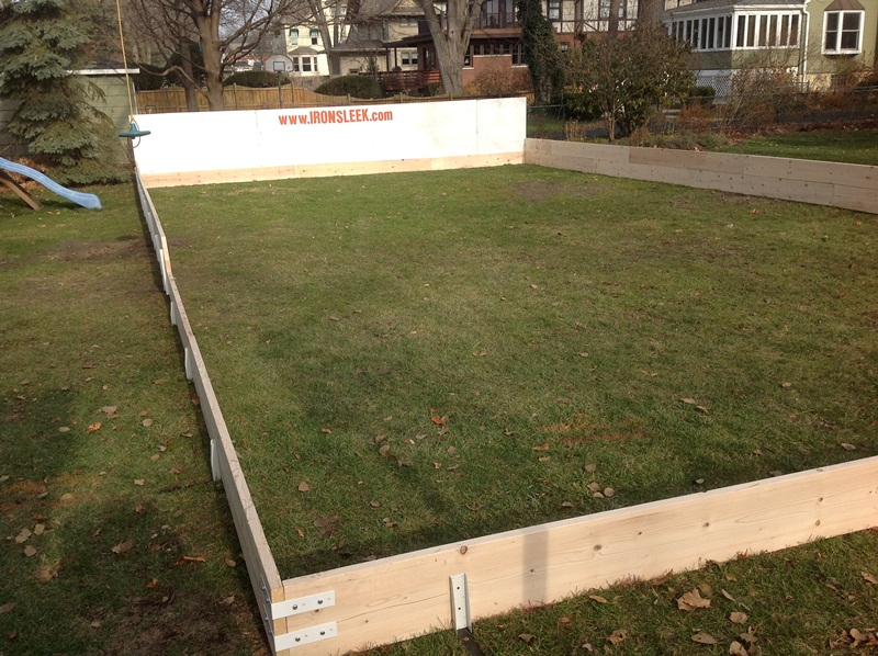 Plywood backyard ice rink boards.